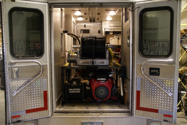Custom installation of a sewer jetter in a used ambulance